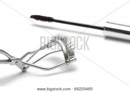 Eyelash curler with fake false eyelash and mascara Isolated on white background