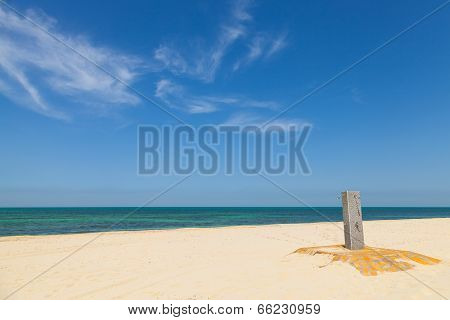 White Empty Sandy Beach With Shower And Beautiful Cloudy Sky