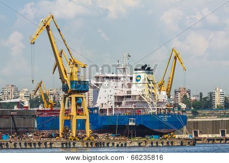 Freighter Ship And Cranes