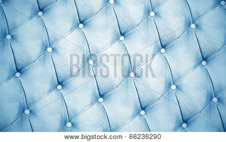 Abstract background texture of an old natural luxury, modern style leather with rhombs. Classic white, black and dark blue grungy skin of retro wall, door, sofa or studio interior with metal buttons.
