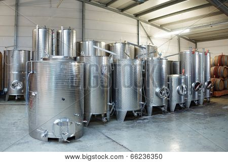 Fermentation stainless steel vats in warehouse