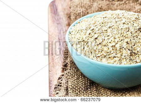 Oat Flakes For Breakfast Isolated On White Background. Healthy Rustic Oatmeal Breakfast