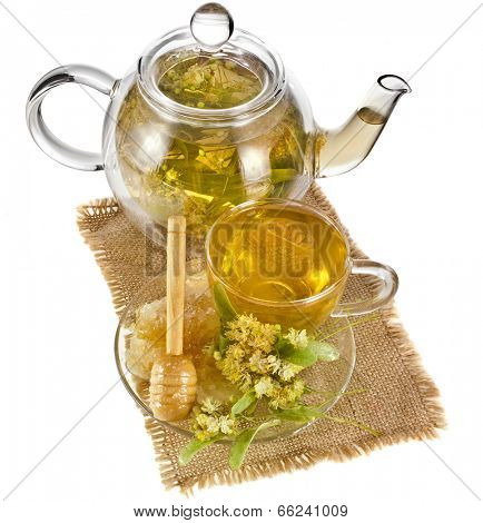 Tea pot with glass tea cup and linden tree bloom isolated on white background