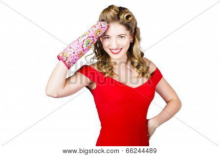 Blond Pinup Woman Saluting In Cooking Glove
