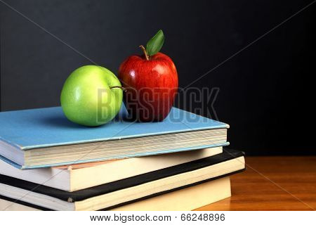 Red And Green Apple On Text Books