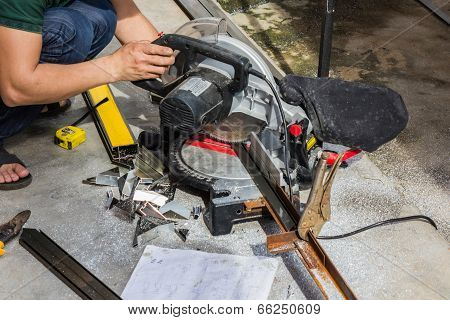 Worker Cutting Steel Tube.