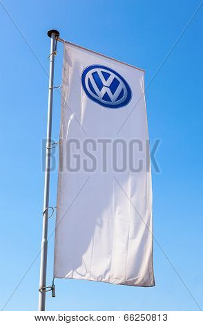 Samara, Russia - May 31, 2014: The Flag Of Volkswagen Over Blue Sky. Volkswagen Is The Biggest Germa