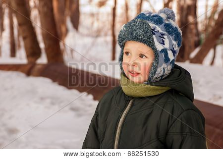 Little Boy Outdoors In Winter