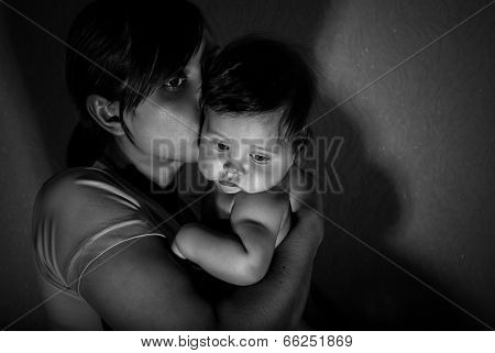 Black And White Portrait Of Happy Mother With Baby.