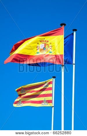 Spanish And European Flags Waving In The Wind