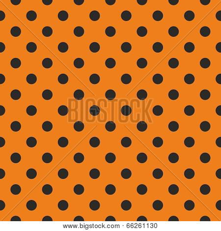 Vector pattern with black polka dots on orange background