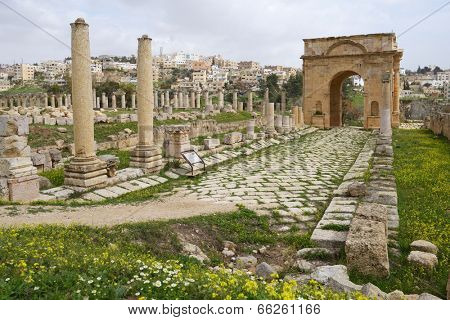JERASH, JORDAN - MARCH 18, 2014: North Tetrapylon in the ancient city of Jerash. Since 2004, Jerash Archaeological City is included in UNESCO Tentative List