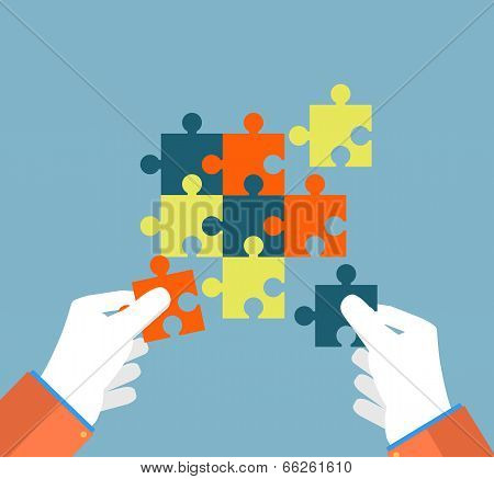 Businessman Assembling Jigsaw Puzzle