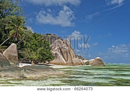 Stretch Of  Sandy Beach Between Picturesque Rock Formations