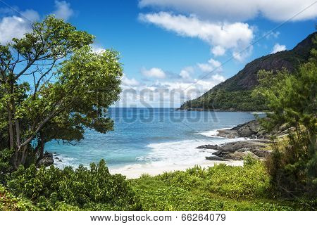 Small Sandy Beach Between Volcanic Rocks