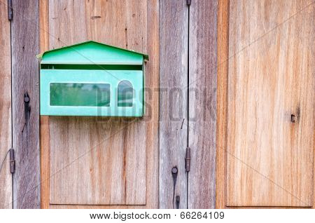 Postbox In Front Of Retro Wooden Door