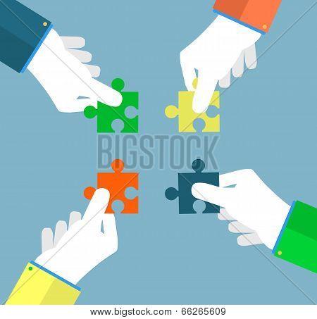 Businessman Assembling Jigsaw Puzzle