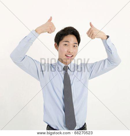 Success businessman thumb up