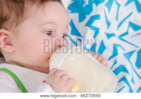Baby Drinking Milk Formula From A Bottle