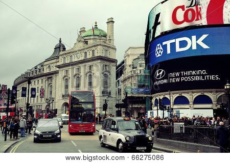 LONDON, UK - SEP 27: Piccadilly Circus street view on September 27, 2013 in London, UK. Built in 1819, it is the major shopping, entertainment areas and key tourist attractions in London.