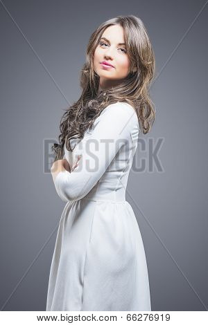 Caucasian Brunette Woman In White Dress