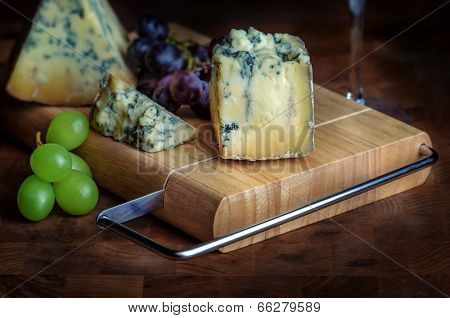 Cheese board stilton mature blue mouldy and grapes