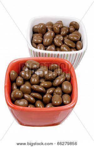 Bowls of Chocolate Coated Raisins