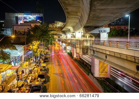 BANGKOK - APRIL 20: View of the city road and traffic near  the Victory Monument BTS Skytrain staion on April 20, 2014 in Bangkok, Thailand