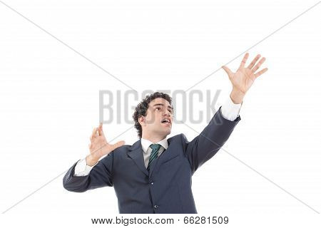 Businessman With Raised Hands Reaching For Something With Blank Space