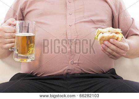 Fat Business Man Holding Beer Mug And Hamburger
