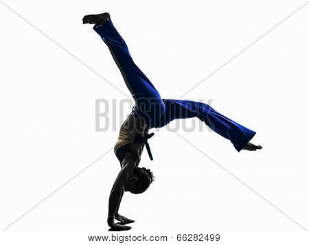 one  woman capoeira dancer dancing in silhouette studio isolated on white background