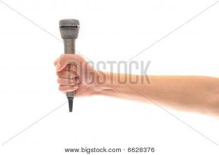 Hand And Arm Holding Microphone Isolated On White