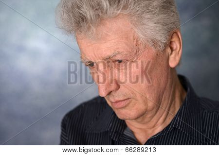 portrait of an thinking elderly man
