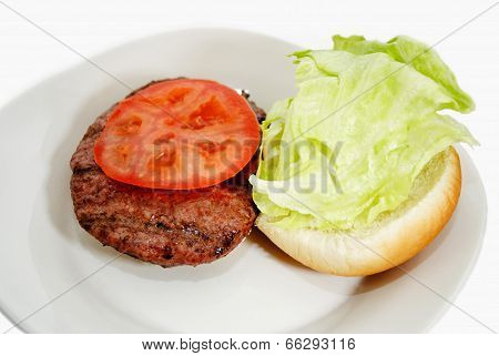 Grilled Burger With Fresh Lettuce And Tomato