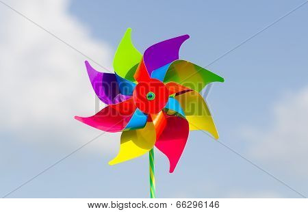 Childish Pinwheel Against Blue Sky Background.