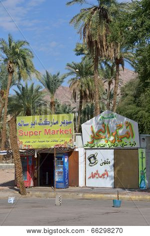 AQABA, JORDAN - MARCH 14, 2014: Small supermarket near the port. Aqaba is duty free shopping zone therefore some goods here offered by lowest price that at the frontier