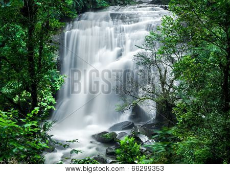 Tropical Rain Forest Landscape With Jungle Plants And Flowing Water Of Sirithan Waterfall. Thailand