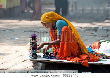 Indian Woman In Colorful Sari Sells Souvenirs