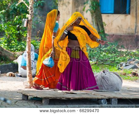 Indian women in colorful sari at city street