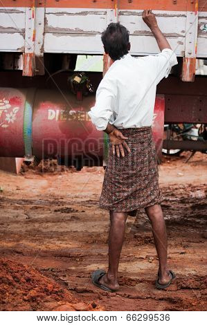 Indian Man Truck Driver In Traditional South Indian Clothes ( Lungi )