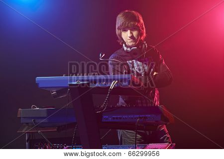 Musician sitting by a keyboard