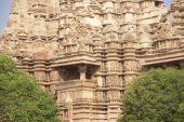 stock photo of kandariya mahadeva temple  - Exterior decorations of the Kandariya Mahadeva Temple at Khajuraho in India Asia - JPG