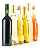 foto of ethanol  - Composition with variety of wine bottles isolated on white - JPG