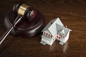 stock photo of eviction  - Gavel and Small Model House on Wooden Table - JPG