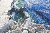 stock photo of fishnet  - Fishnet closeup in afternoon sunlight - JPG