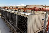 stock photo of air compressor  - Industrial air conditioner on the roof with blue sky - JPG