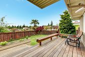 pic of lawn chair  - Wooden deck with benches and chair - JPG