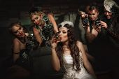 foto of vaudeville  - Photographers is taking a picture of a beautiful cabaret girls - JPG