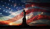 foto of statue liberty  - Statue of Liberty on the background of flag usa sunrise and fireworks - JPG