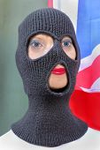 stock photo of terrorist  - Female terrorist with rib knit three hole balaclava